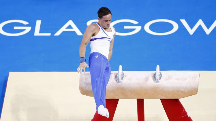 Daniel Keatings of Scotland performs during men's pommel horse apparatus final at the 2014 Commonwealth Games in Glasgow, Scotland