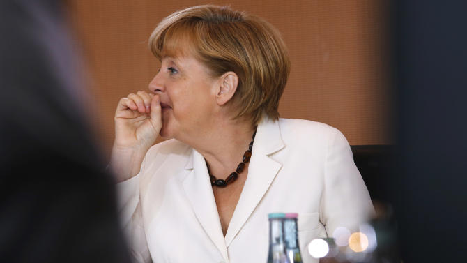 """FILE - In this July 10, 2013 file picture, German Chancellor Angela Merkel gestures prior to the weekly cabinet meeting in Berlin . Allegations of widespread U.S. data surveillance have created turbulence for Angela Merkel on what so far looked like a smooth cruise to a third term as German chancellor, even though it remains to be seen whether the flap will threaten her seriously. Merkel's center-left opponents have seized on disclosures of National Security Agency surveillance programs by leaker Edward Snowden to assert that she hasn't been doing enough to confront Washington and protect Germans' personal data - and to cast doubt on officials' assertions that they didn't know of the programs. The opposition apparently hopes that the issue will breathe life into a so-far stumbling and gaffe-prone campaign for Sept. 22 parliamentary elections. A healthy economy, low unemployment and perceptions that Merkel has managed Europe's debt crisis well have bolstered the chancellor. Merkel's center-left challenger, Peer Steinbrueck, is suggesting that the government turned a blind eye to violations of Germans' rights and that Merkel violated her oath of office, in which she swore to """"keep damage from"""" her people. (AP Photo/Ferdinand Ostrop,File)"""