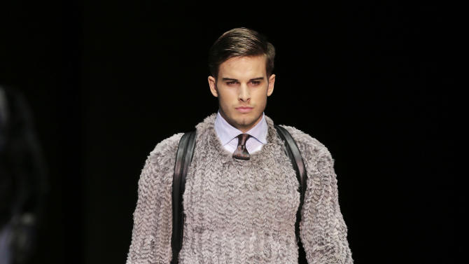 A model wears a creation for Emporio Armani men's Fall-Winter 2013-14 collection, part of the Milan Fashion Week, unveiled in Milan, Italy, Monday, Jan. 14, 2013. (AP Photo/Antonio Calanni)