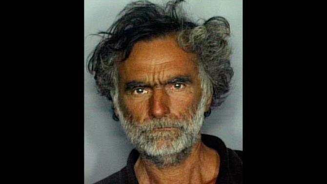 """FILE - This undated booking file photo made available by the Miami-Dade Police Dept. shows Ronald Poppo. In a  July 19, 2012 recorded interview, Poppo, 65,  told investigators the man who approached him, Rudy Eugene,  initially seemed friendly.  Poppo said Eugene then """"turned berserk"""" and attacked, chewing on his face and plucking at his eyes.  Eugene, 31, was shot and killed by a Miami police officer during the attack. (AP Photo/Miami-Dade Police Dept., File)"""