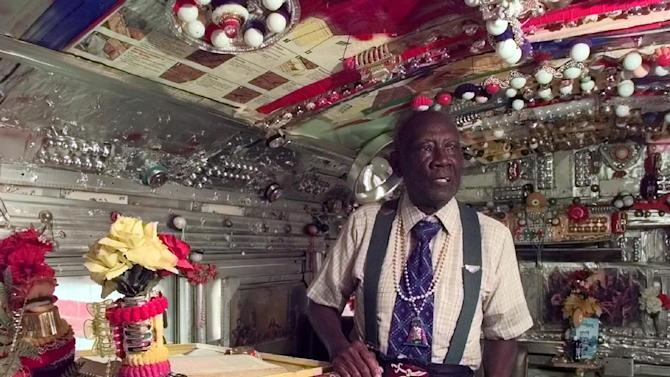 """In this 1998 photo,  Rev. H.D. Dennis, poses inside """"The House of Prayer,"""" an ornately decorated school bus at his home at Margaret's Grocery near Vicksburg, Miss. The Rev. Herman """"Preacher"""" Dennis, who turned a Mississippi Delta grocery store into a folk-art castle that became a roadside attraction, has died, Tuesday, Sept. 4, 2012. He was 96. (AP Photo/The Clarion-Ledger)  NO SALES"""
