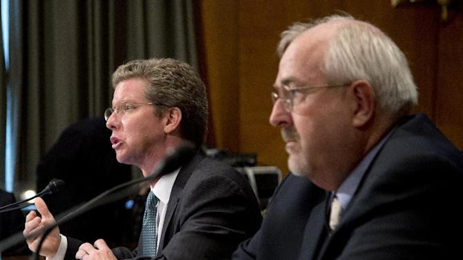 Housing and Urban Development (HUD) Secretary Shaun Donovan, left, and Federal Emergency Management Agency (FEMA) Administrator Craig Fugate, testify on Capitol Hill in Washington, Wednesday, Dec. 5, 2012, before a Senate Homeland Security subcommittee hearing to examine Superstorm Sandy, focusing on response and recovery and progress and challenges.    (AP Photo/Manuel Balce Ceneta)