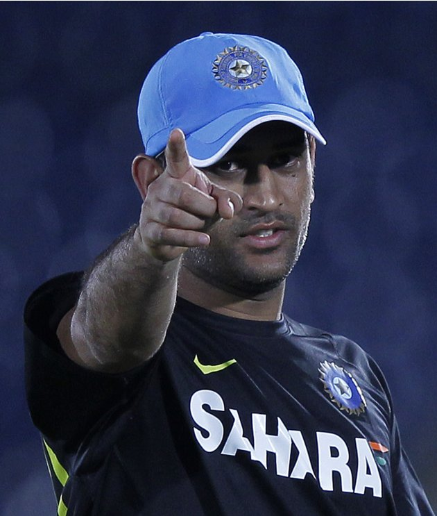 India's cricket captain Mahendra Singh Dhoni points his finger as he shows some areas in the ground to bowlers during a practice session ahead of their first One Day International cricket match ag