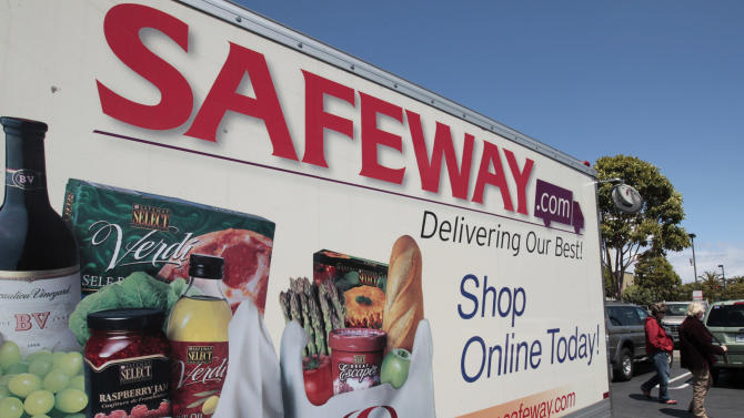 FILE- In this Thursday, April 26, 2012, file photo, a Safeway online shopping advertisement is shown at a Safeway store in San Francisco. Safeway Inc. reports quarterly financial results before the market opens on April 25, 2013. (AP Photo/Paul Sakuma, File)