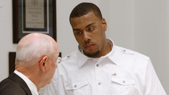 Oklahoma State forward Darrell Williams, right, talks with his attorney, Willie Baker following a court appearance, Friday, July 8, 2011, in Stillwater, Okla. A judge entered a not guilty plea and set a new court date for Williams, who faces five felony counts alleging he inappropriately touched two women at an off-campus party