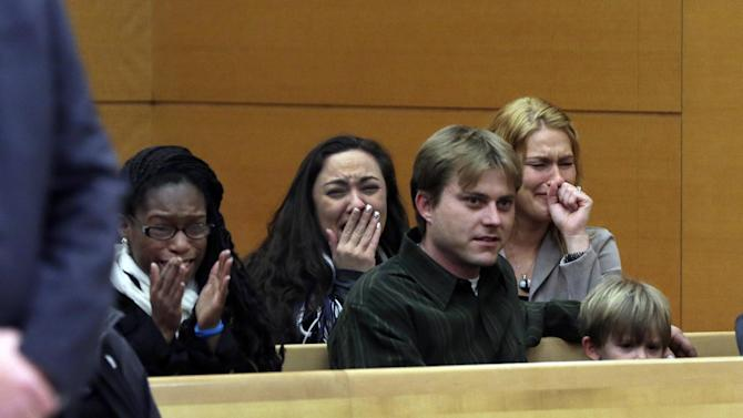 Family members react as David Ranta is freed, in state Supreme Court in Brooklyn, New York,  Thursday, March 21, 2013. Ranta, 58, who spent more than two decades behind bars was freed by Judge Miriam Cyrulnik on Thursday after a reinvestigation of his case cast serious doubt on evidence used to convict him in the Feb. 8, 1990 shooting of Rabbi Chaskel Werzberger. (AP Photo/Richard Drew, Pool)