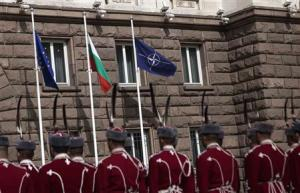 Bulgarian honour guard soldiers attend a flag-raising ceremony as part of celebrations of the 10th anniversary of Bulgaria joining NATO, in Sofia