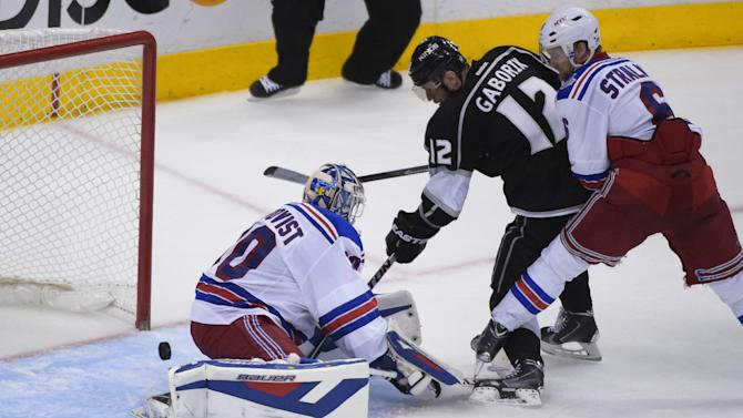 Los Angeles Kings right wing Marian Gaborik (12), of Slovakia, scores a goal as New York Rangers goalie Henrik Lundqvist, of Sweden,, left, looks on during the third period in Game 5 of the NHL Stanley Cup Final series Friday, June 13, 2014, in Los Angeles. (AP Photo/Mark J. Terrill)