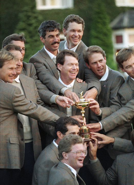 FILE - This Sept. 26, 1993, file photo shows American Ryder Cup captain Tom Watson, center, posing with his winning team after they were presented with the trophy at the Belfry Golf Club in Sutton Col