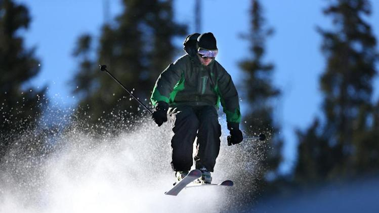 FILE - In this Oct. 13, 2013 file photo provided by Colorado Ski Country USA, a skier enjoys opening day at Arapahoe Basin Ski Area in Colorado. Colorado Ski Country USA, a trade association that represents 21 resorts, is informing visitors through social media about the new pot laws, which were passed last year and legalize marijuana possession in small amounts for adults over 21, including out-of-state visitors. Ski industry officials note that it's still illegal to smoke marijuana in public and on federal land, where 90 percent of Colorado's ski resorts are located. (AP Photo/Colorado Ski Country USA, Jack Dempsey)