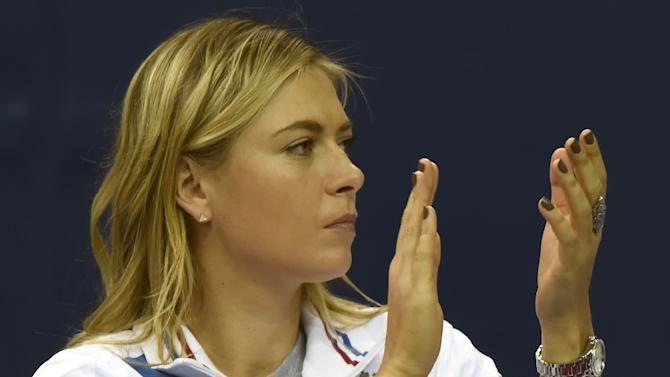 Russia's Maria Sharapova has quit the Qatar Open due to injury