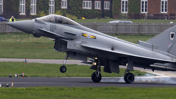 An RAF Typhoon fighter aircraft lands at RAF base Northolt, where four of the aircraft will be based as part of the Olympics related security exercise in west London, Wednesday, May 2, 2012. The Typhoon interceptor aircraft forms a part of a co-ordinated defence against possible threats to the London 2012 Olympic games, involving all three of the British armed services, with high end weaponry including a missile defence system, fighter aircraft and AWACS aircraft. (AP Photo/Alastair Grant)