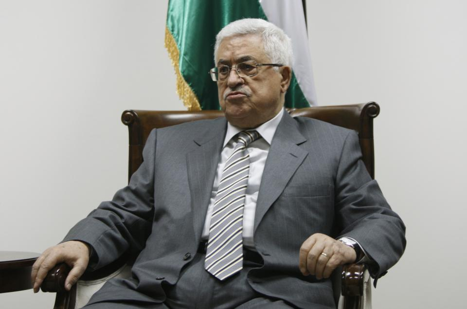 Palestinian President Mahmoud Abbas pauses during a meeting with Palestinian doctors at his office in the West Bank city of Ramallah, Tuesday, Sept. 6, 2011. A delegation of 40 Palestinian medics met with Abbas on Tuesday before leaving on an aid mission to Libya. (AP Photo/Majdi Mohammed)