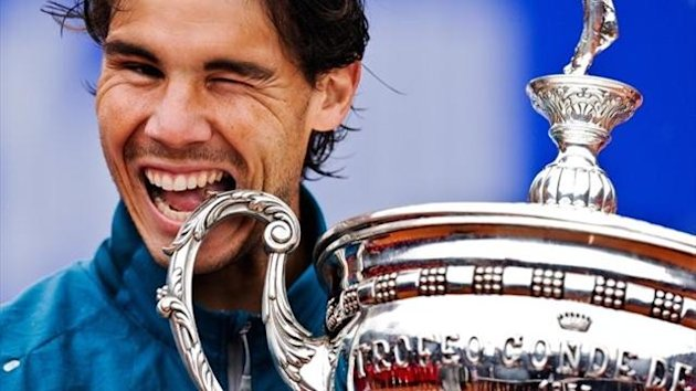 Rafa Nadal with the ATP Barcelona trophy. Again.