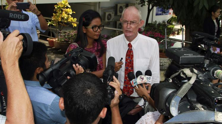 Morison and Sidasathian, reporters for the Phuketwan news website, speak to media as they arrive to a criminal court in Phuket