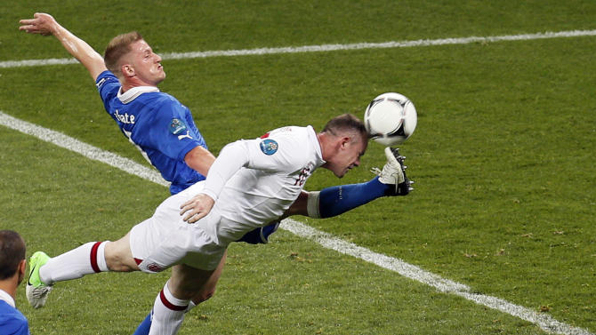 Italy's Ignazio Abate, left, and England's Wayne Rooney go for the ball during the Euro 2012 soccer championship quarterfinal match between England and Italy in Kiev, Ukraine, Sunday, June 24, 2012. (AP Photo/Vadim Ghirda)