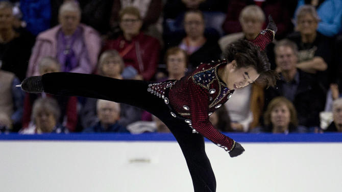 Takahito Mura, of Japan, skates during the men's short program of the Skate Canada figure skating event in Kelowna, British Columbia, Friday, Oct. 31, 2014. (AP Photo/The Canadian Press, Jonathan Hayward)