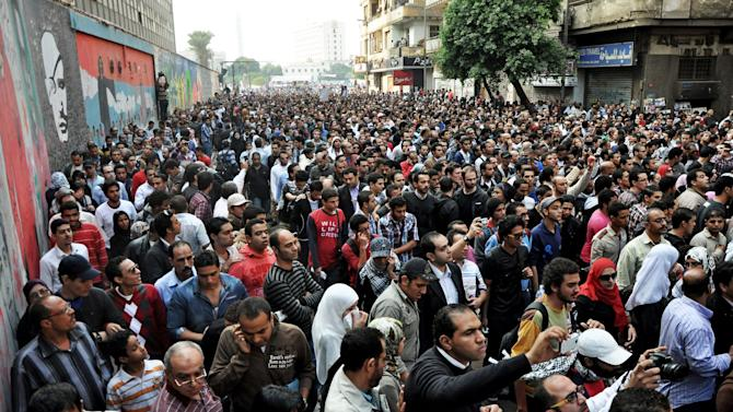Egyptians attend the funeral of Gaber Salah, who was who was killed in clashes with security forces in Cairo, Egypt, Monday, Nov. 26, 2012. Thousands of Egyptians on Monday gathered into Cairo's Tahrir Square to attend the funeral of Salah, who was severely injured during clashes with security forces last week and died Sunday night. (AP Photo/Hussein Tallal)