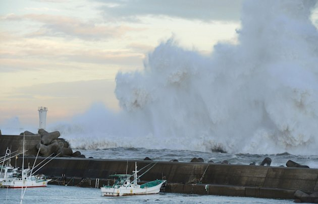High waves hit a breakwater in Kihocho, Mie prefecture, western Japan Sunday, Sept. 30, 2012. A powerful typhoon is heading to Tokyo after injuring dozens of people, causing blackouts and paralyzing traffic in southern Japan. (AP Photo/Kyodo News) JAPAN OUT, MANDATORY CREDIT, NO LICENSING IN CHINA, FRANCE, HONG KONG, JAPAN AND SOUTH KOREA