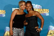 FILE- In this June 24, 2008 file photo, Tionne &quot;T-Boz&quot; Watkins, left, and Rozonda &quot;Chilli&quot; Thomas pose backstage at the BET Awards in Los Angeles. For R&B singer Tionne &quot;T-Boz&quot; Watkins of the Grammy-winning TLC, it has been a rocky road since the 2002 death of Lisa &quot;Left Eye&quot; Lopez. Now, she puts her life on display through her new reality show, &quot;Totally T-Boz,&quot; an hour-long, four-episode series that airs on cable network TLC on Tuesdays, which premiered on Jan. 1, 2013. (AP Photo/Danny Moloshok, File)