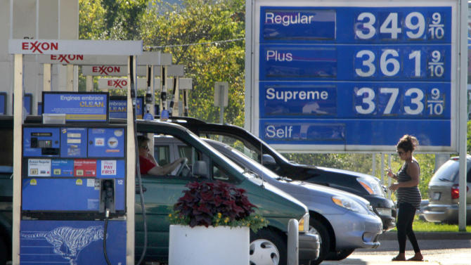 In this Sept. 27, 201 photo, cars line up at the pumps at an Exxon mini-mart in Carnegie, Pa. Companies paid more for gas and food in September to drive wholesale prices up by the most in five months. Outside those volatile categories, inflation was modest. (AP Photo/Gene J. Puskar)
