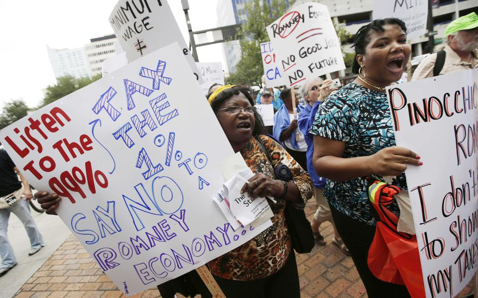 Demonstrators march, in Tampa, Fla., Sunday, Aug. 26, 2012. Hundreds of protestors gathered in Gas Light Park in downtown Tampa to march in demonstration against the Republican National Convention. (AP Photo/Dave Martin)