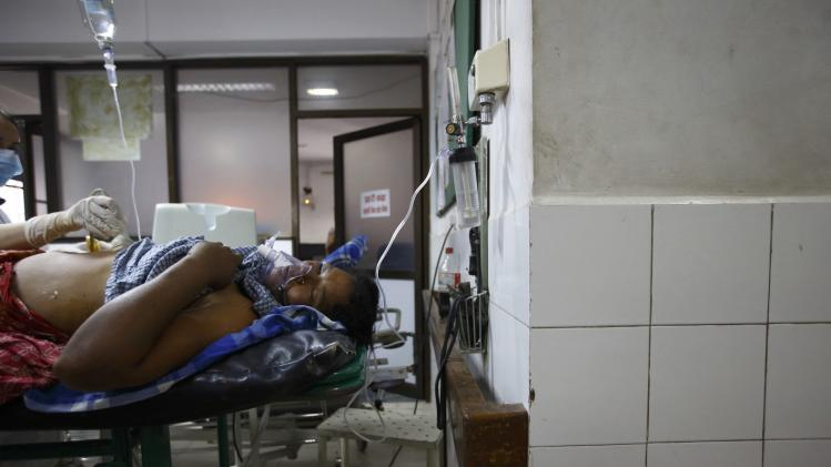 A landslide victim undergoes treatment at a hospital in Kathmandu