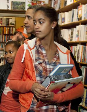 FILE - In this Nov. 26, 2011 file photo, President Barack Obama shops with his daughters Malia, foreground, and Sasha, in Washington. The White House says President Barack Obama's oldest daughter, Malia, is safe and never was in danger during a strong earthquake Tuesday in Mexico. (AP Photo/Carolyn Kaster, File)