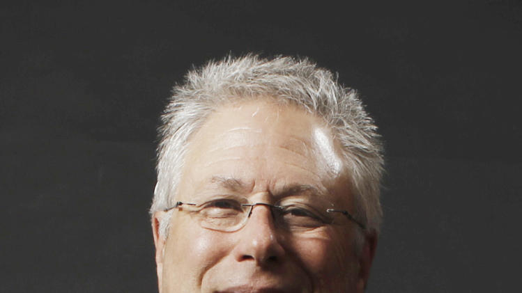 "FILE - This Feb. 7, 2011 shows composer Songwriter Alan Menken at the Academy Award Nominees Luncheon in Beverly Hills, Calif. Menken is nominated for a Grammy Award for best theater album for the Broadway musical ""Newsies."" (AP Photo/Matt Sayles, file)"
