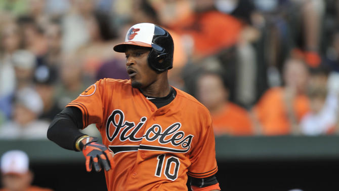 Baltimore Orioles' Adam Jones follows through on a RBI single against the New York Yankees in the first inning of a baseball game, Saturday, June 29, 2013, in Baltimore. (AP Photo/Gail Burton)
