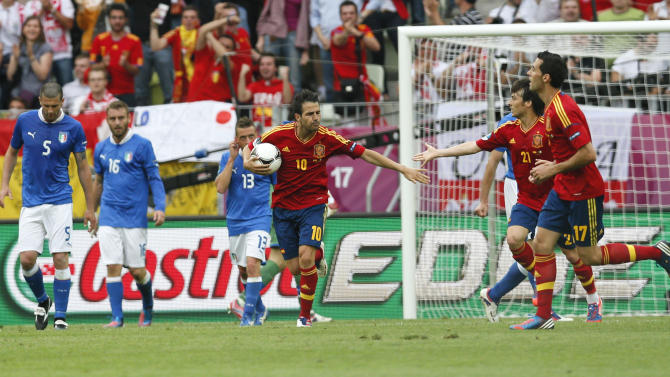 Spain's Cesc Fabregas, center, celebrates with teammate, after scoring a goal during the Euro 2012 soccer championship Group C match between  Spain and Italy in Gdansk, Poland, Sunday, June 10, 2012. (AP Photo/Michael Sohn)