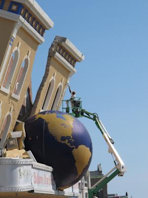 In this Sept. 14, 2012 photo, a worker touches up the paint job on the Ripley's Believe It Or Not museum on the Atlantic City N.J. Boardwalk. New Jersey officials are evaluating efforts to improve the seaside gambling resort as calls mount for them to approve casino gambling in other parts of the state. (AP Photo/Wayne Parry)