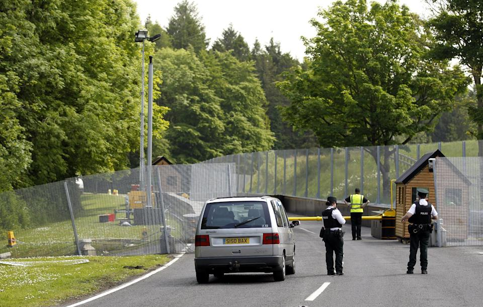 Police officers man a checkpoint close to the Lough Erne Golf Resort, Enniskillen, Northern Ireland, Thursday, June 6, 2013. The G8 summit will be held at Lough Erne on June 17-18. (AP Photo/Peter Morrison)