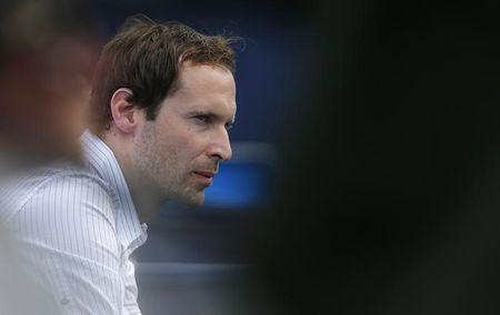 Chelsea's goalkeeper Cech watches the men's singles tennis match between Czech Republic's Stepanek and South Africa's Anderson at the Queen's Club Championships in west London