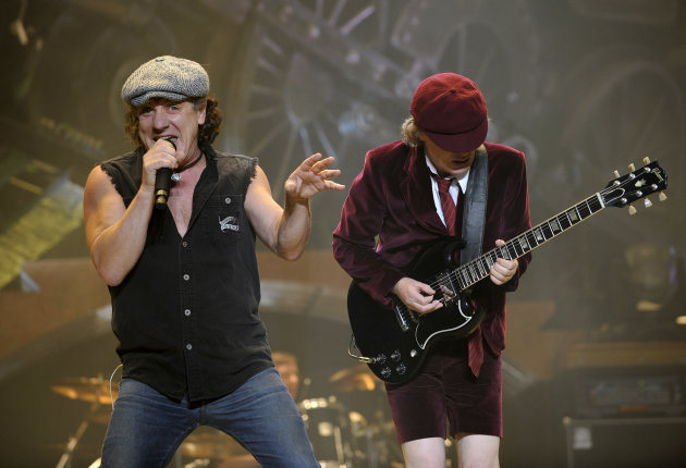 FILE - In this Nov. 12, 2008 file photo, AC/DC lead singer Brian Johnson, left, and Angus Young perform on the Black Ice tour at Madison Square Garden in New York. Columbia Records and Apple announced Monday, Nov. 19, 2012, that the classic rock band&#39;s music will be available at the iTunes Store worldwide. Sixteen albums will be released, including &quot;High Voltage&quot; and &quot;Back in Black.&quot; (AP Photo/Jeff Zelevansky, file)