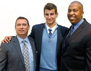 Austin Hatch is shown with his uncle Michael Hatch (L) and Loyola coach Jamal Adams. (AP)