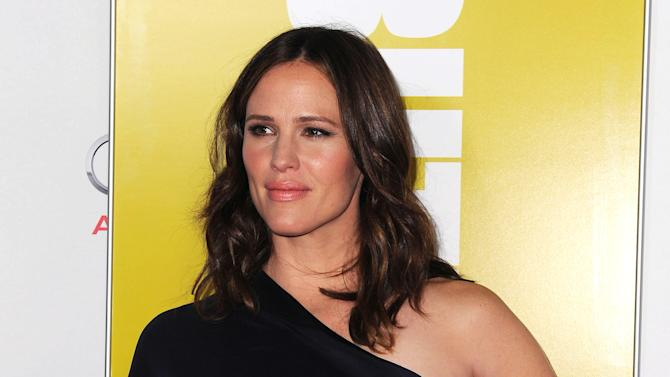 "Jennifer Garner arrives at the AFI special screening of ""Butter"" at Grauman's Chinese Theater, Sunday, Nov. 6, 2011, in Los Angeles. (AP Photo/Katy Winn)"