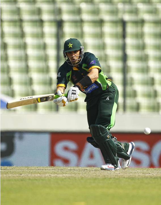 Pakistan's cricket captain Misbah-ul-Haq plays a shot during the Asia Cup final cricket match between Sri Lanka and Pakistan in Dhaka, Bangladesh, Saturday, March 8, 2014. (AP Photo/A.M. Ahad)