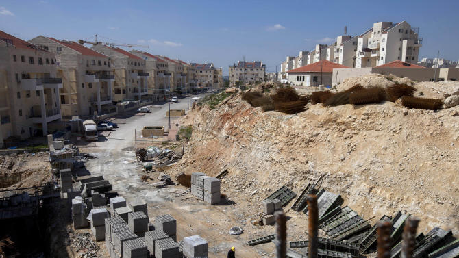 """FILE- In this March 14, 2011, file photo, a general view of a construction site in the West Bank Jewish settlement of Modiin Illit. Israel approved the construction of 3,000 homes in Jewish settlements in the West Bank and east Jerusalem, a government official said Friday, in what appeared to be a defiant response to the Palestinians' successful United Nations recognition bid. The United Nations voted overwhelmingly Thursday to accept """"Palestine"""" in the West Bank, the Gaza Strip and east Jerusalem as a non-member observer state, setting off jubilant celebrations among Palestinians. (AP Photo/Oded Balilty, File)"""