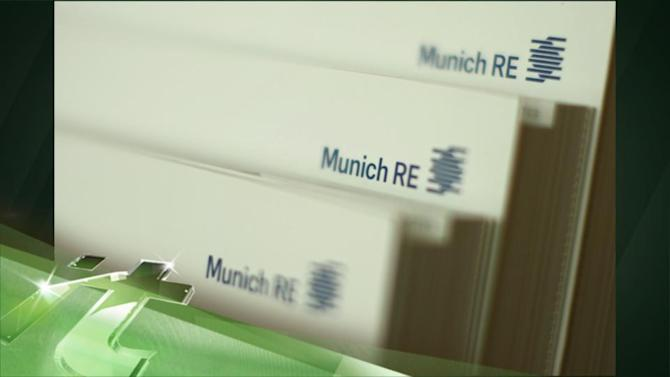 Latest Business News: Floods Hit Profits at Munich Re