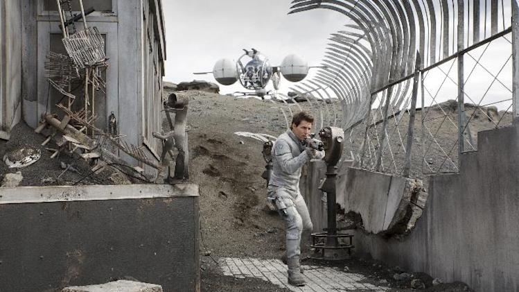 "This film publicity image released by Universal Pictures shows Tom Cruise in a scene from ""Oblivion."" (AP Photo/Universal Pictures)"