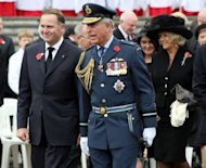 Prince Charles (C) and his wife Camilla (R) join New Zealand PM John Key (L) during Armistice Day commemorations at the Auckland War Memorial on November 11. The royal couple arrived in New Zealand on the last leg of their tour marking Queen Elizabeth II's diamond jubilee