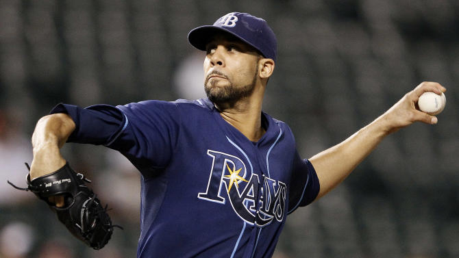 Tampa Bay Rays starting pitcher David Price throws against the Baltimore Orioles in the third inning of a baseball game on Tuesday, Sept. 13, 2011, in Baltimore. (AP Photo/Patrick Semansky)