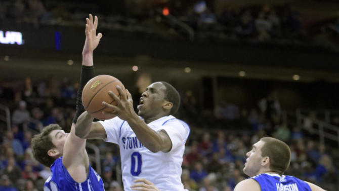 Seton Hall's Khadeen Carrington goes up with a shot between Creighton's Avery Dingman, left, and Zach Hanson, right, during the second half of an NCAA college basketball game Saturday, Jan. 28, 2015, in Newark, N.J. Seton Hall won 67-66. (AP Photo/Bill Kostroun)