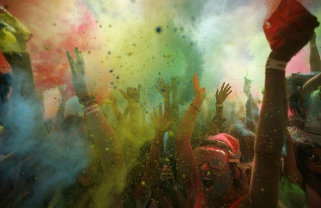 Revellers are covered in coloured cornflour powder as they take part in the Holi One festival in Cape Town