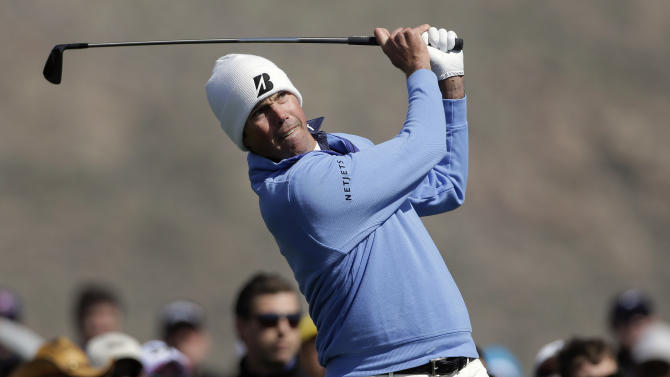Matt Kuchar tees off on the third hole in the final round of play against Hunter Mahan during the Match Play Championship golf tournament, Sunday, Feb. 24, 2013, in Marana, Ariz. (AP Photo/Ted S. Warren)