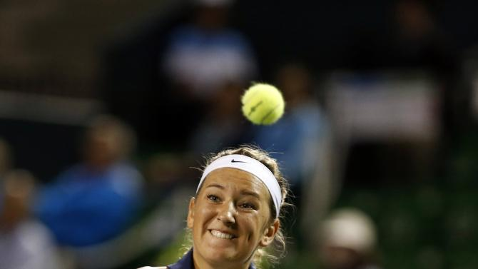 Azarenka of Belarus eyes the ball as she returns a shot to Ivanovic of Serbia during their Pan Pacific Open women's singles tennis match in Tokyo