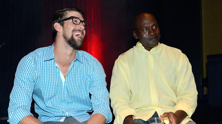 From left, former U.S. Olympic swimmer Michael Phelps and Charlotte Bobcats owner Michael Jordan attend the Michael Jordan Celebrity Invitational opening night dinner, Wednesday, April, 3, 2013 in Las Vegas. (Photo by Jeff Bottari/Invision for Jordan/AP Images)