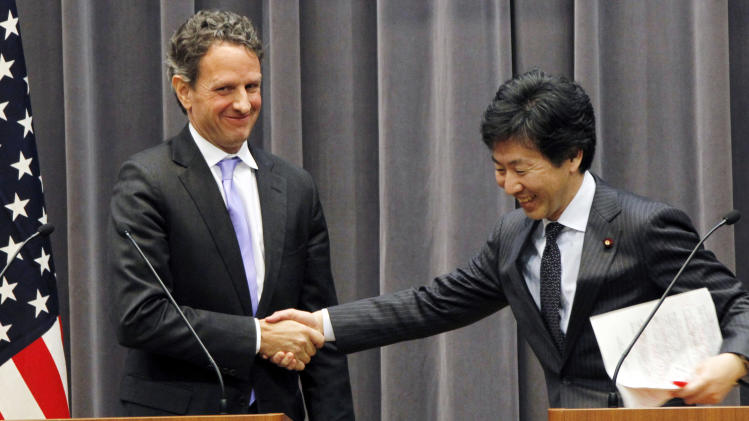 U.S. Treasury Secretary Timothy Geithner, left, shakes hands with his Japanese counterpart Jun Azumi after their joint press conference in Tokyo, Thursday, Jan. 12, 2012. (AP Photo/Koji Sasahara)