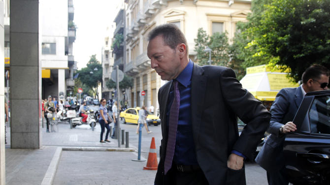 Greece's Finance Minister Yannis Stournaras arrives at the Finance Ministry prior a meeting with debt inspectors from the European Central Bank, the European Commission and  the International Monetary Fund, known as the troika  in Athens, on Friday, Oct. 5, 2012.(AP Photo/Petros Giannakouris)